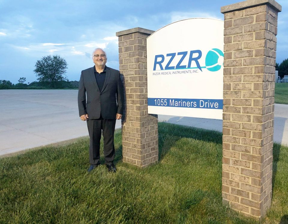 RAZOR Medical Instruments Inc., President, Bruce Khalili, stands in front of the company's new sign and entrance on Mariners Drive in Warsaw.